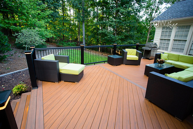 deck with green furniture