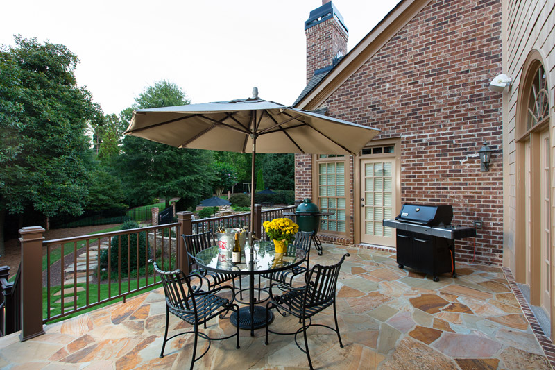 deck with umbrella and grill